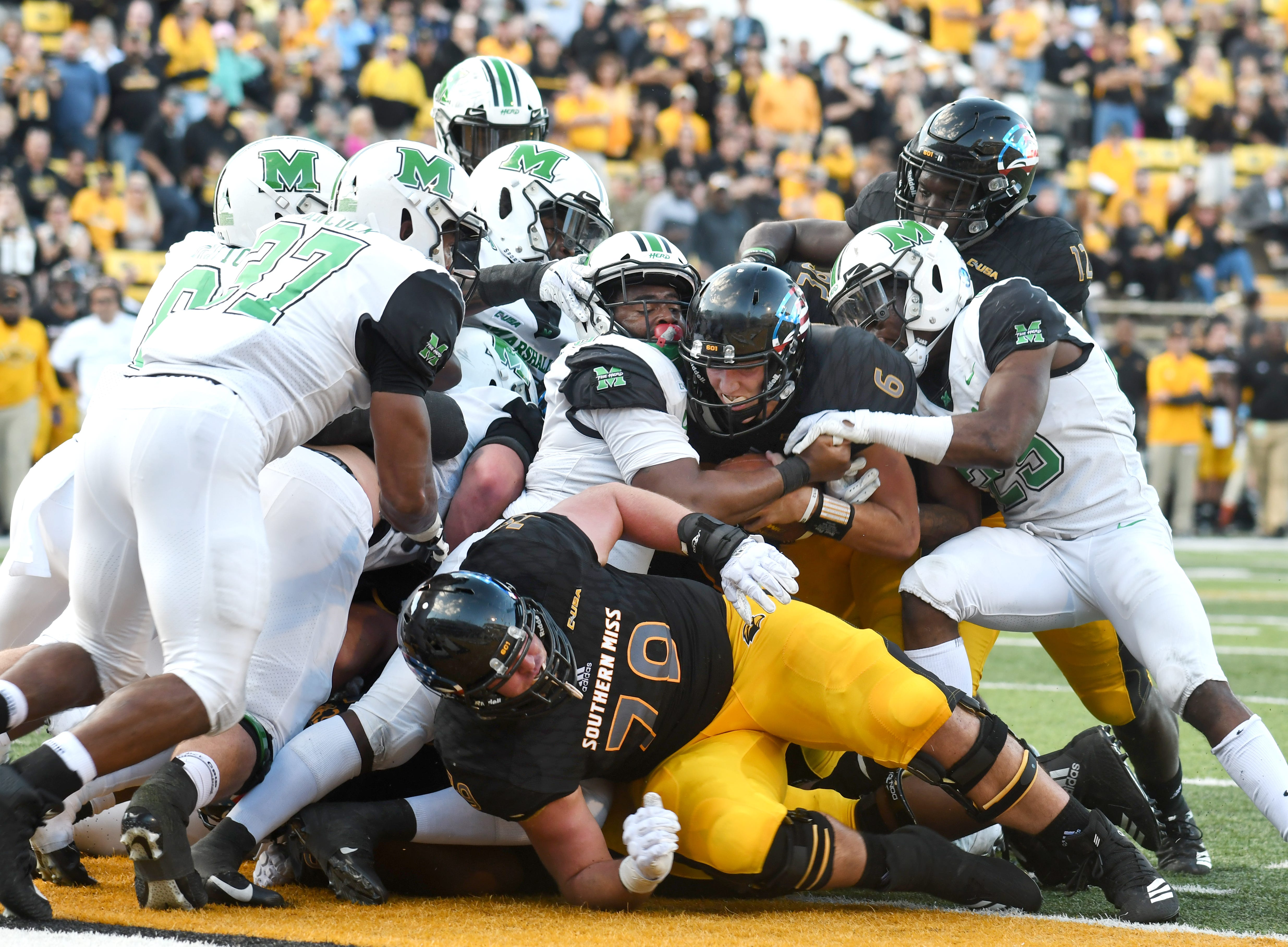 Southern Miss quarterback Tate Whatley runs the ball for a touchdown in a game against Marshall at M.M. Roberts Stadium on Saturday, November 3, 2018.