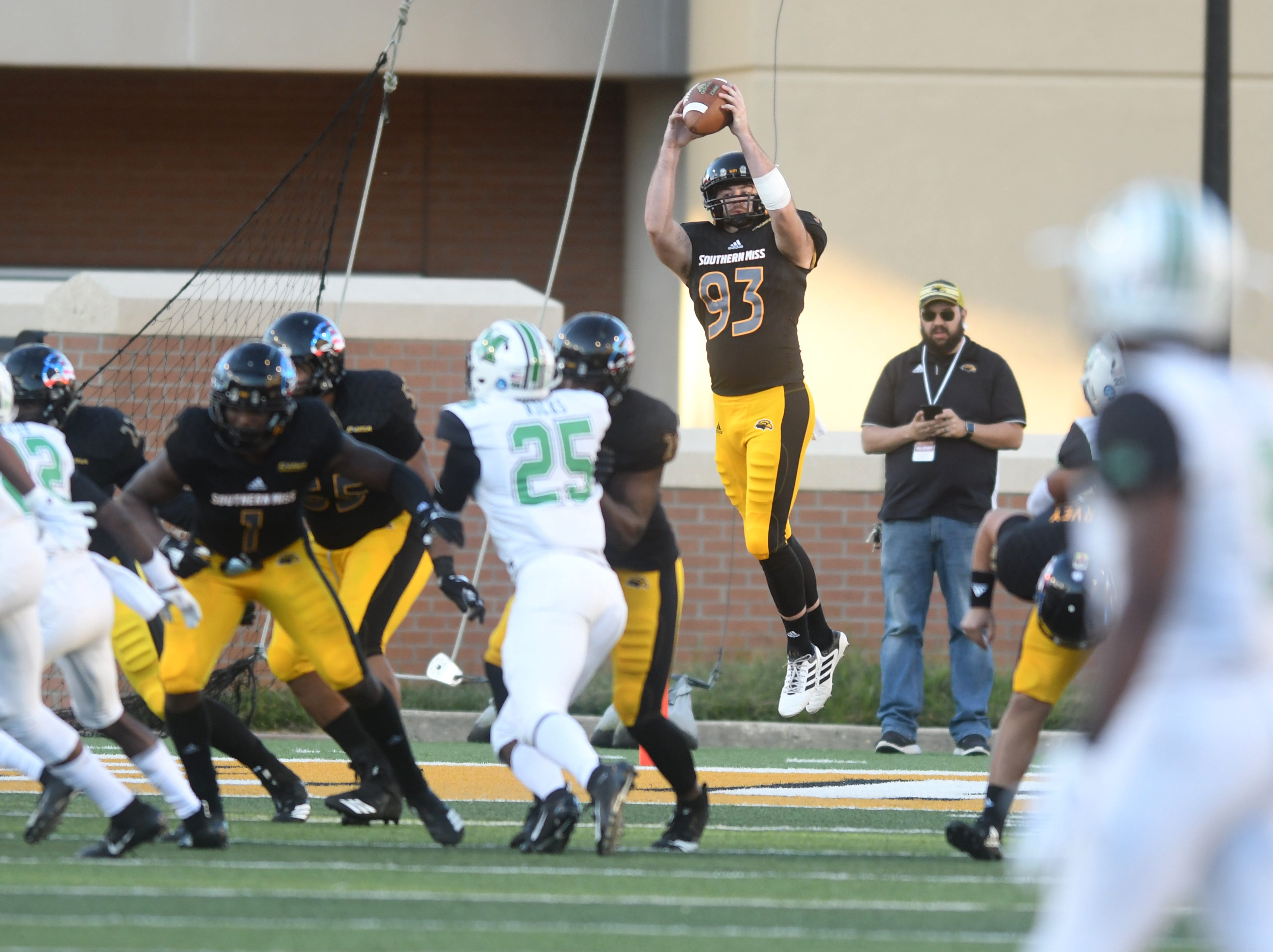 Southern Miss punter Zac Everett jumps to catch a high snap in a game against Marshall at M.M. Roberts Stadium on Saturday, November 3, 2018.