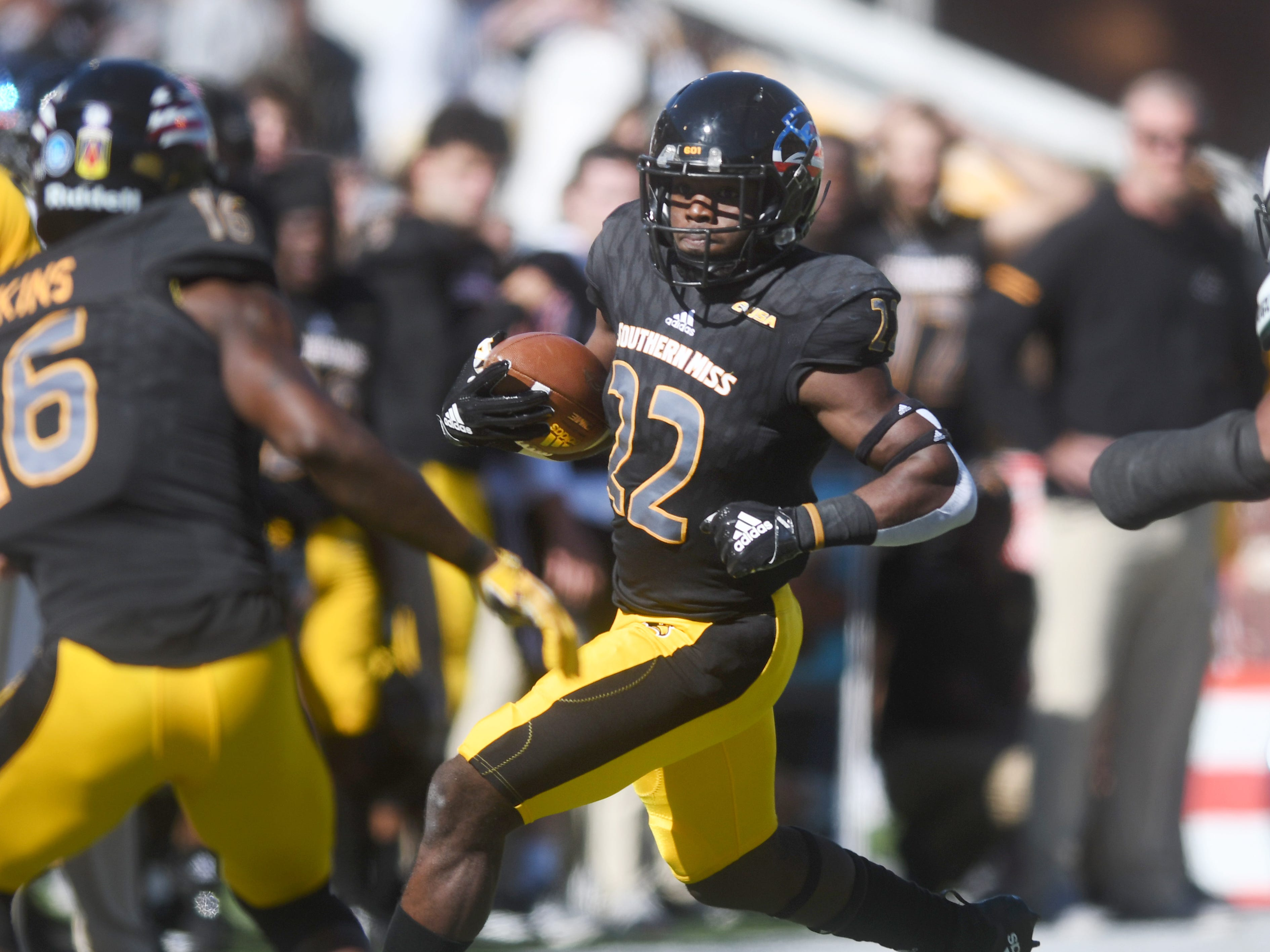 Southern Miss running back Trivenskey Mosley carries the ball down the field in a game against Marshall at M.M. Roberts Stadium on Saturday, November 3, 2018.