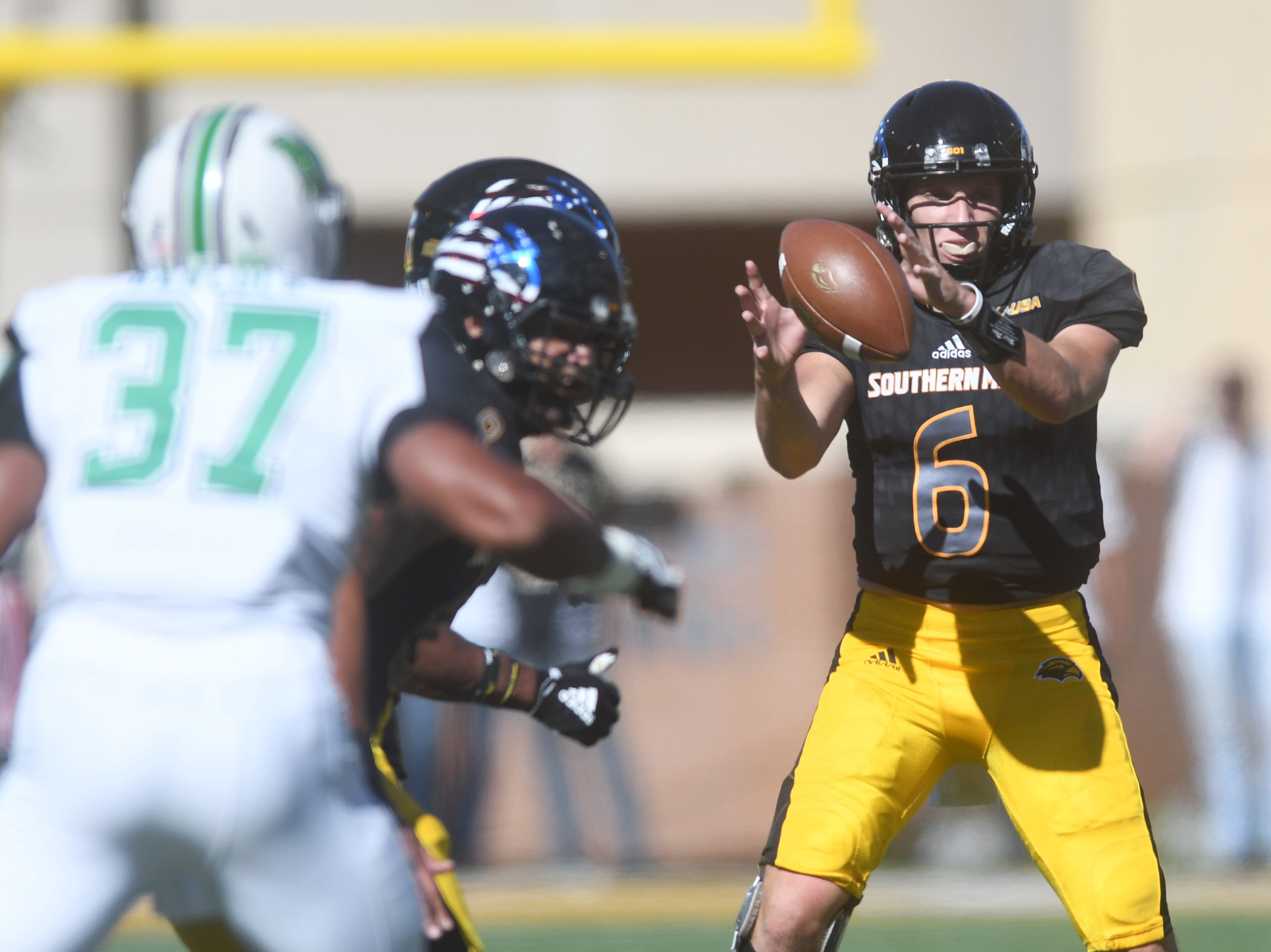 Southern Miss quarterback Tate Whatley receives the ball in a game against Marshall at M.M. Roberts Stadium on Saturday, November 3, 2018.