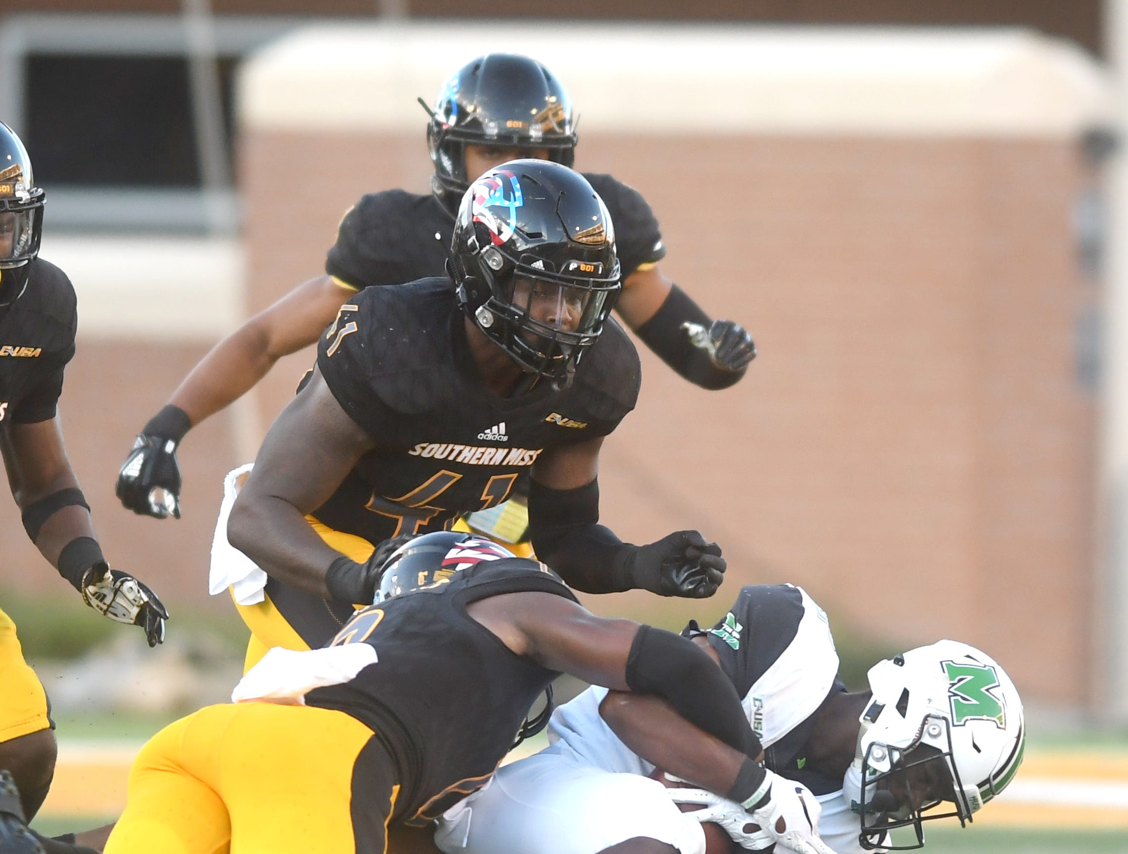 The Southern Miss defense makes a stop in a game against Marshall at M.M. Roberts Stadium on Saturday, November 3, 2018.