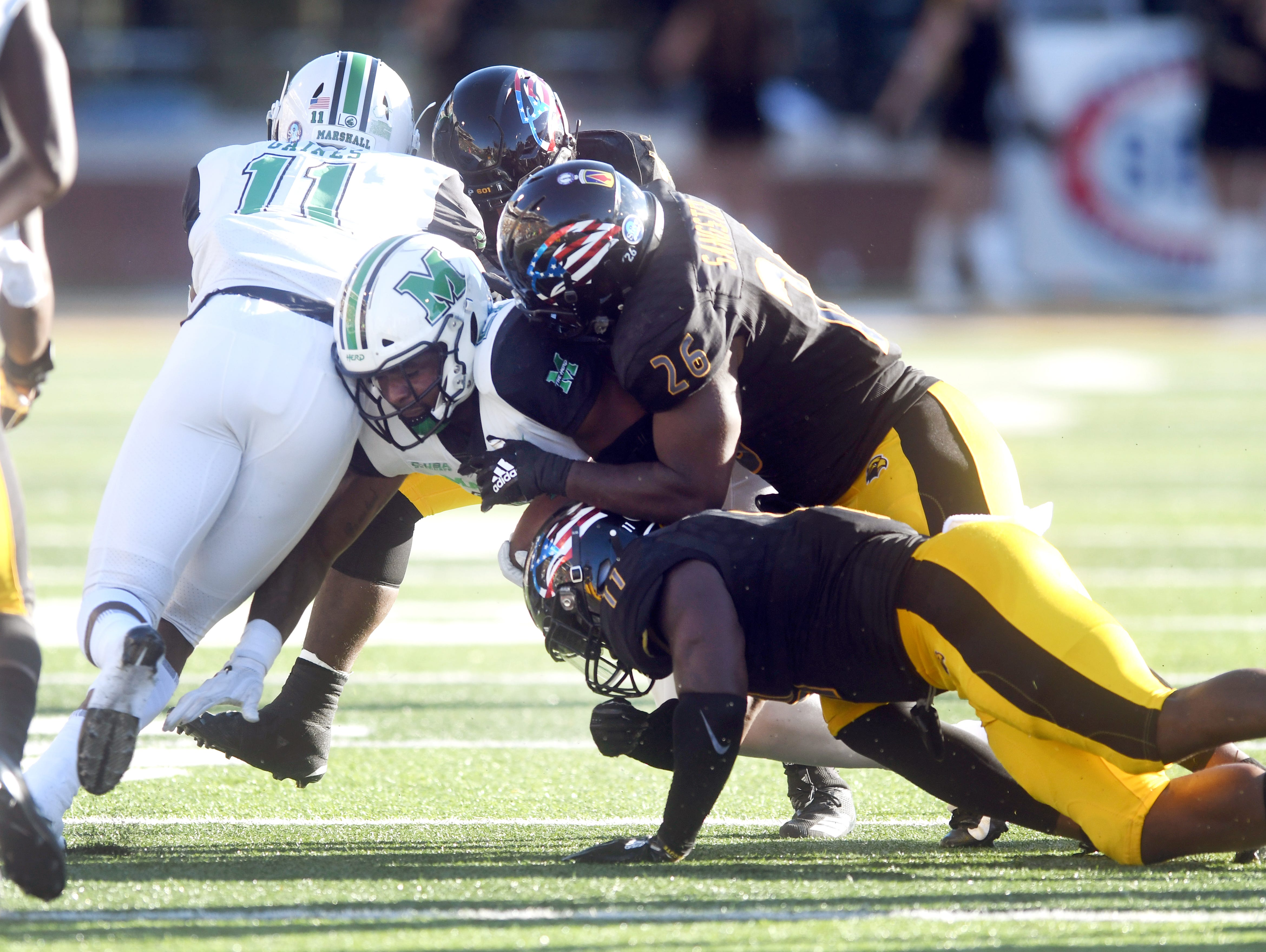 Southern Miss linebacker Jeremy Sangster makes a tackle in a game against Marshall at M.M. Roberts Stadium on Saturday, November 3, 2018.