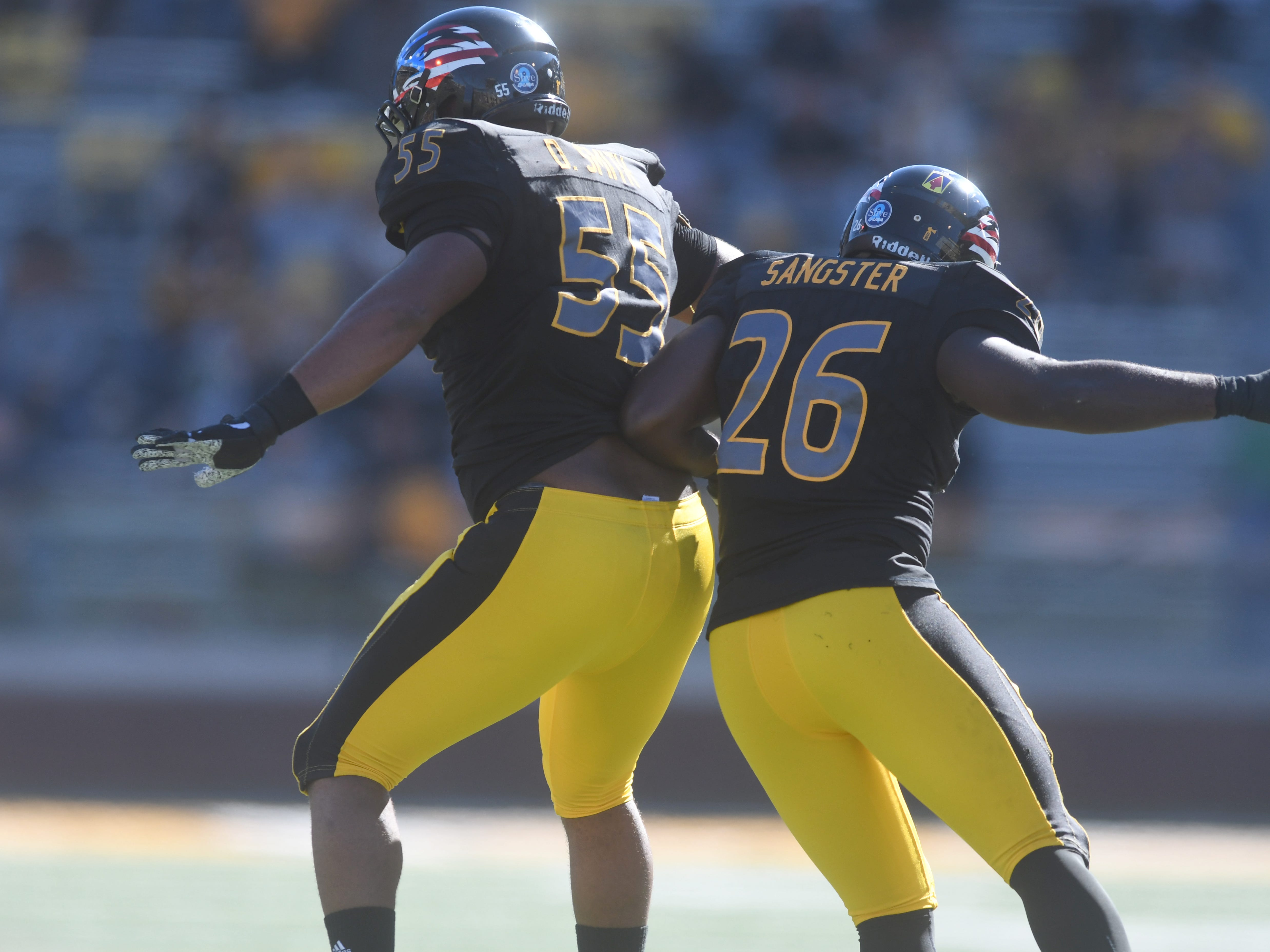 Southern Miss linemen Jeremy Sangster (26) and Demarrio Smith celebrate after a sopped play in a game against Marshall at M.M. Roberts Stadium on Saturday, November 3, 2018.