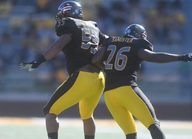 Southern Miss linemen Jeremy Sangster (26) and Demarrio Smith celebrate after a stop against Marshall at M.M. Roberts Stadium on Saturday, November 3, 2018.