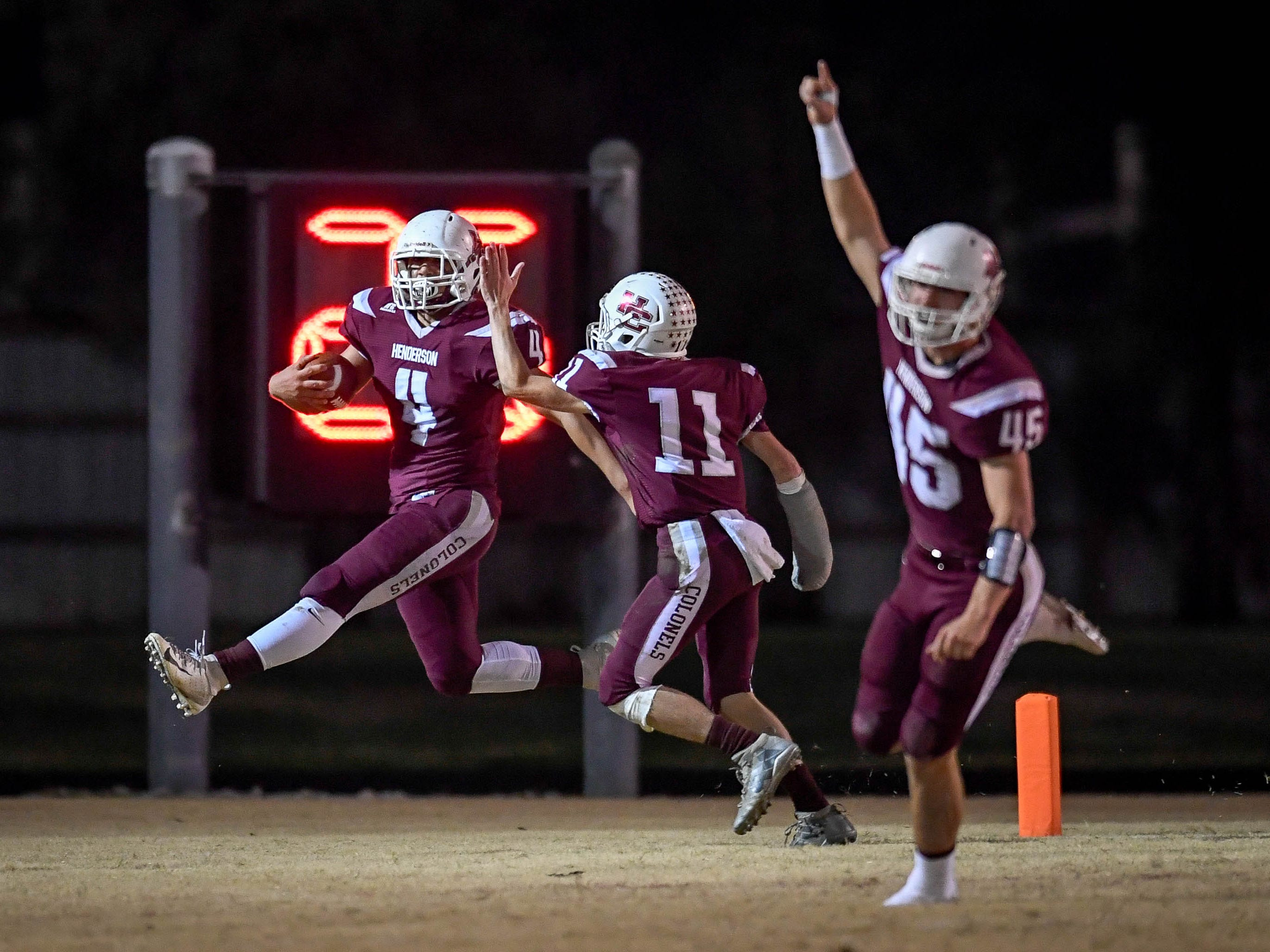Henderson's Layton Fletcher (4), Garrett Greenwell (11)  and Ian Pitt (45) celebrate touchdown from a fumble recovery as the Henderson County Colonels play the Louisville Eastern Eagles in the first round of the 6-A playoffs at Colonel Field Friday, November 2, 2018.