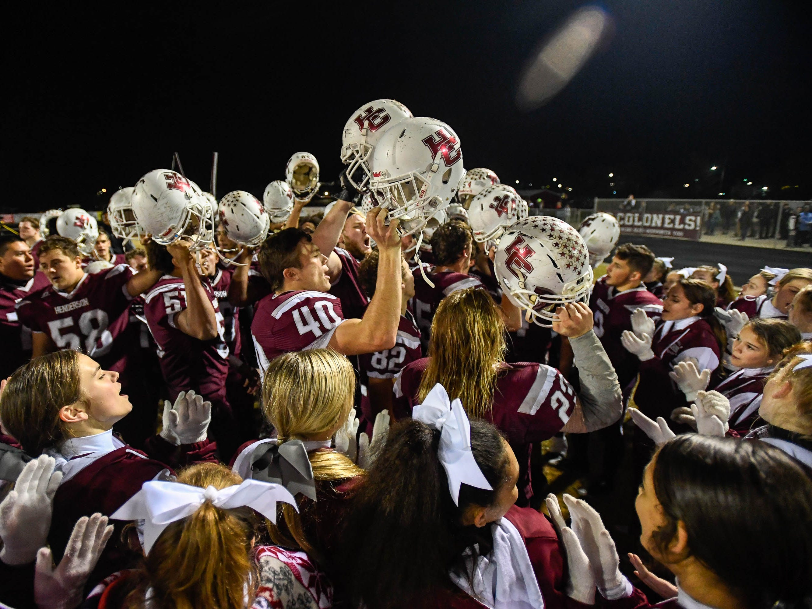 The Henderson County Colonels celebrate a 35-0 win over the Louisville Eastern Eagles in the first round of the 6-A playoffs at Colonel Field Friday, November 2, 2018.