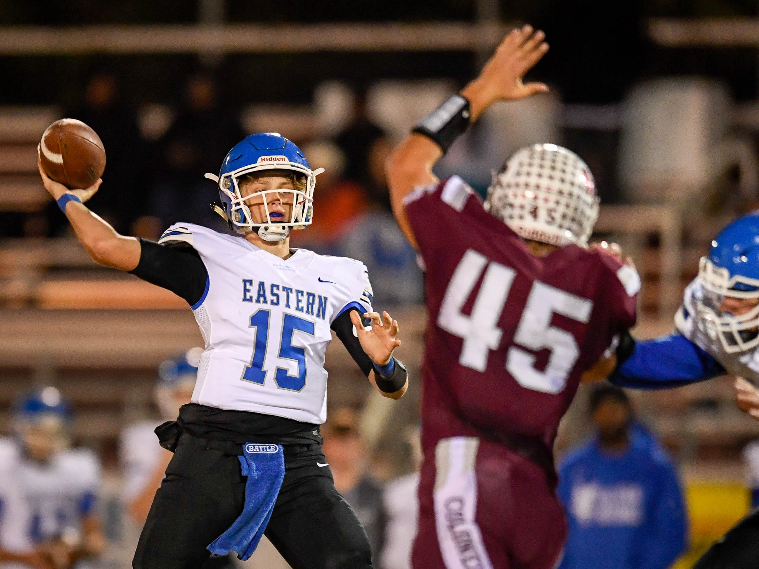 Henderson's Ian Pitt (45) puts pressure on Eastern quarterback Sean Basey (15) as the Henderson County Colonels play the Louisville Eastern Eagles in the first round of the 6-A playoffs at Colonel Field Friday, November 2, 2018.