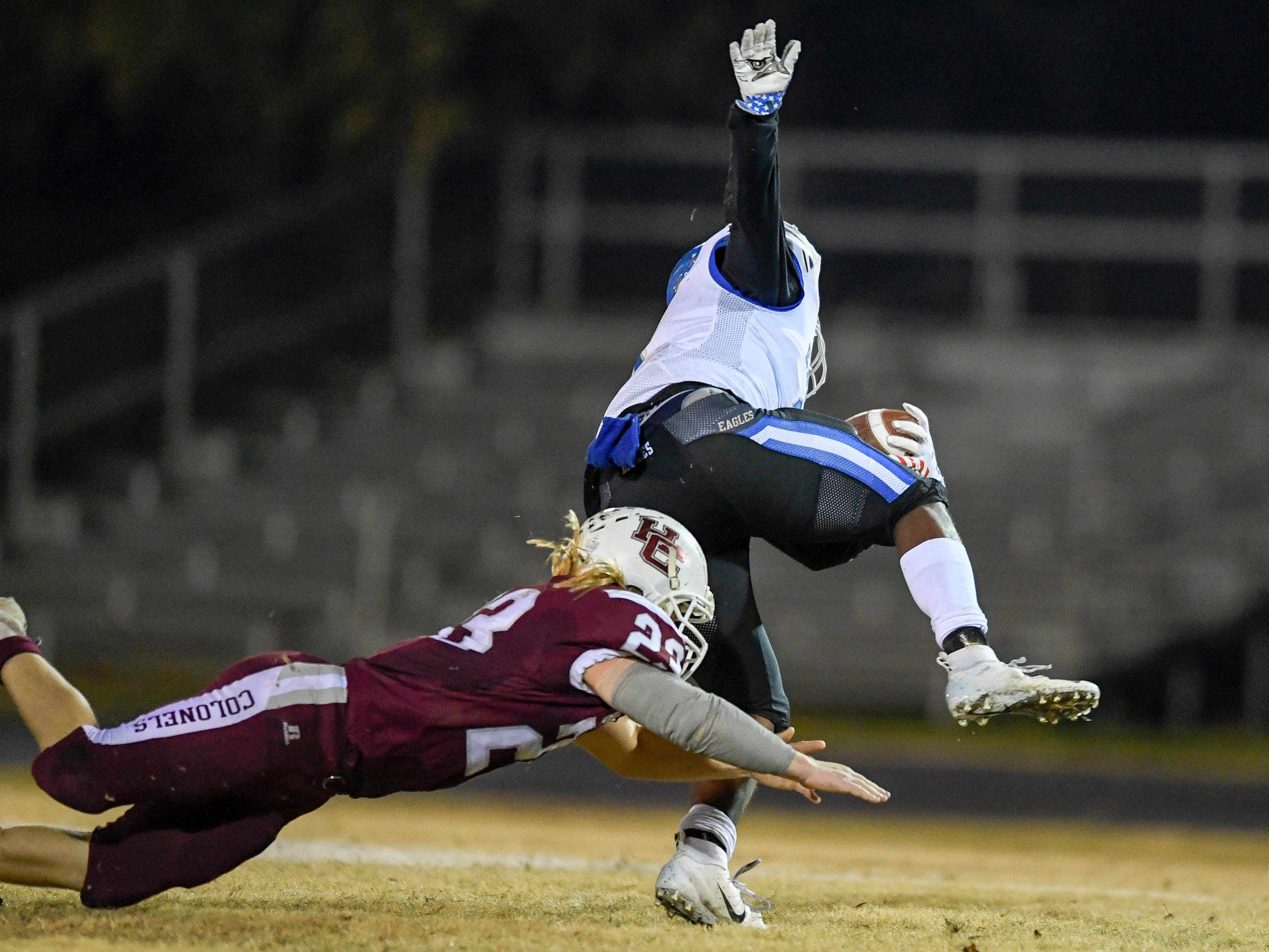 Henderson's Meric Stinson (23) tackles Eastern's Elijah Irvine (3) as the Henderson County Colonels play the Louisville Eastern Eagles in the first round of the 6-A playoffs at Colonel Field Friday, November 2, 2018.