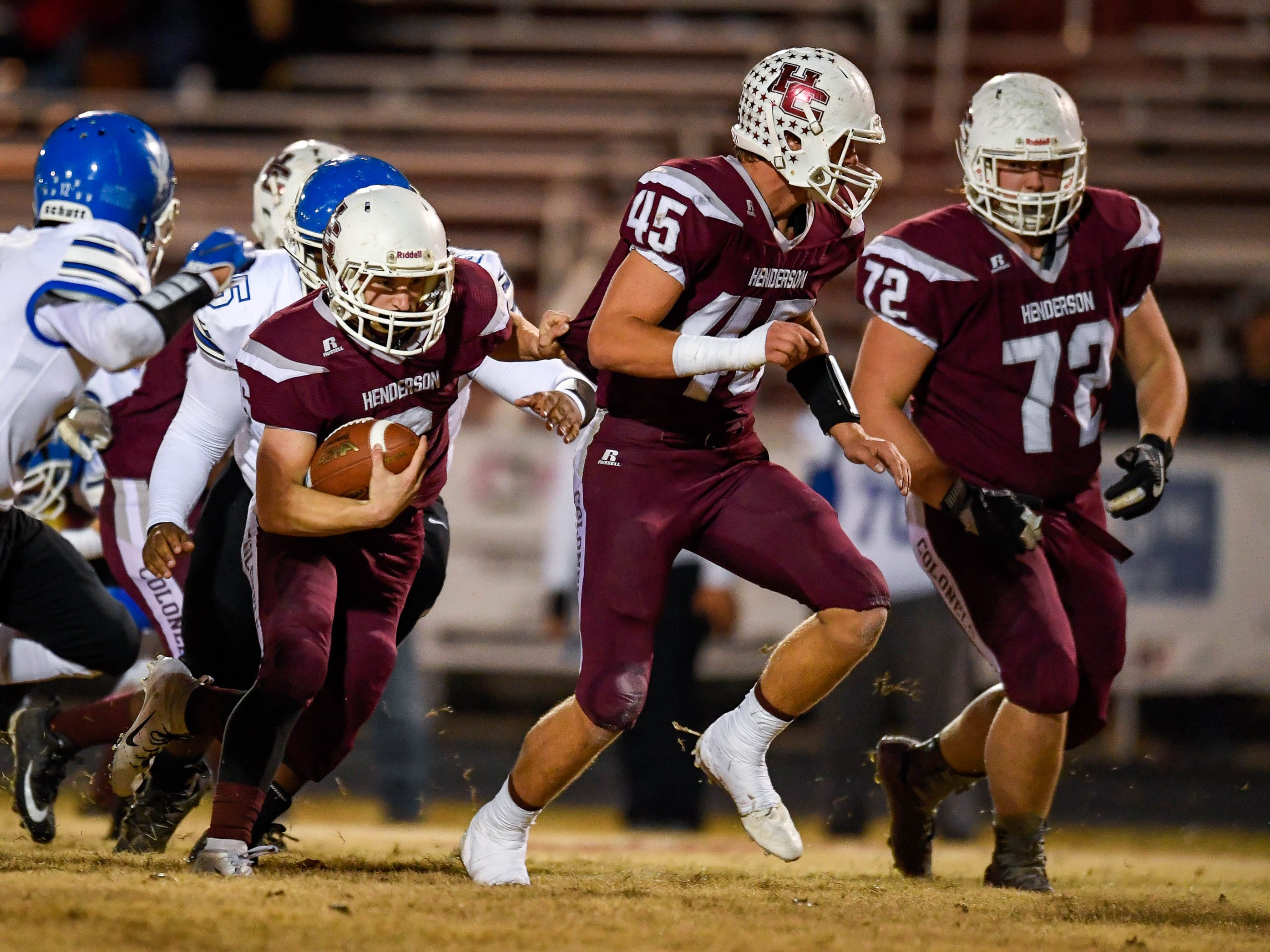 Henderson's Logan Green (6) runs behind blocking from Ian Pitt (45) as the Henderson County Colonels play the Louisville Eastern Eagles in the first round of the 6-A playoffs at Colonel Field Friday, November 2, 2018.