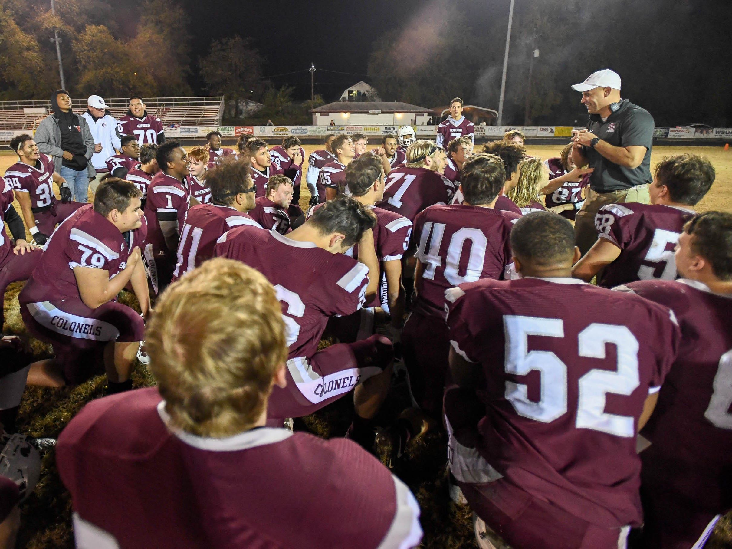 Henderson head coach Josh Boston talks to his team after a 35-0 win over the Louisville Eastern Eagles in the first round of the 6-A playoffs at Colonel Field Friday, November 2, 2018.