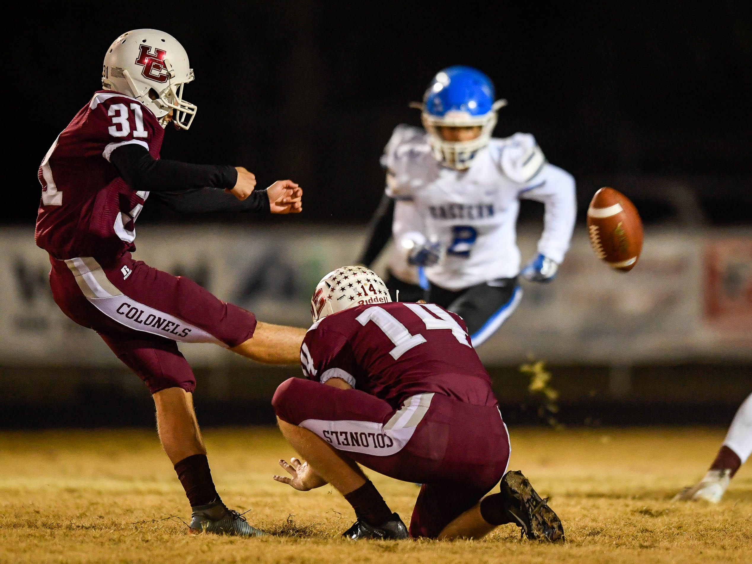Henderson's Jaxon Stauffer (31) kicks a extra point as the Henderson County Colonels play the Louisville Eastern Eagles in the first round of the 6-A playoffs at Colonel Field Friday, November 2, 2018.