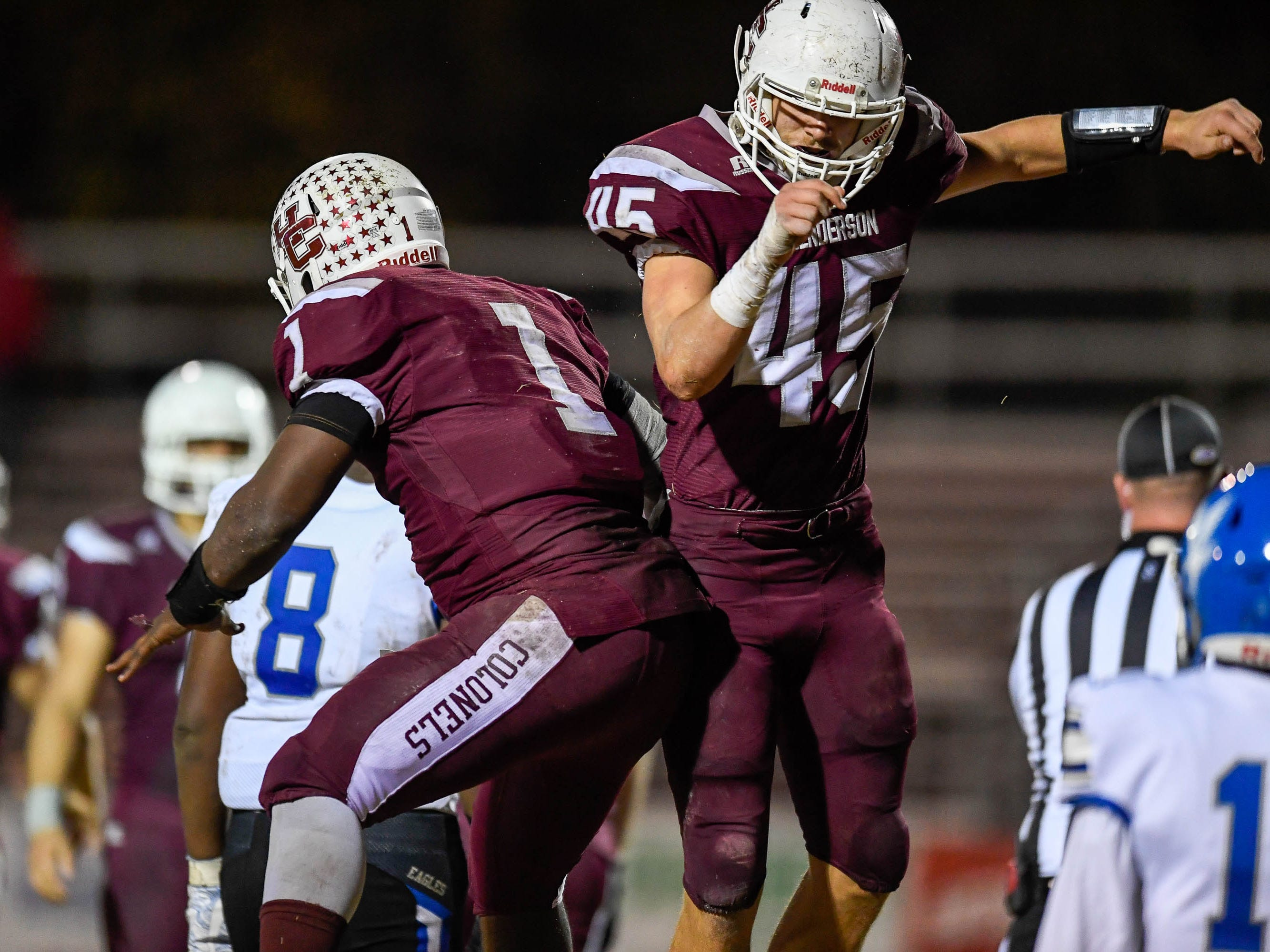 Henderson's Ian Pitt (45) and quarterback Skip Patterson (1) celebreate a touchdown pass as the Henderson County Colonels play the Louisville Eastern Eagles in the first round of the 6-A playoffs at Colonel Field Friday, November 2, 2018.