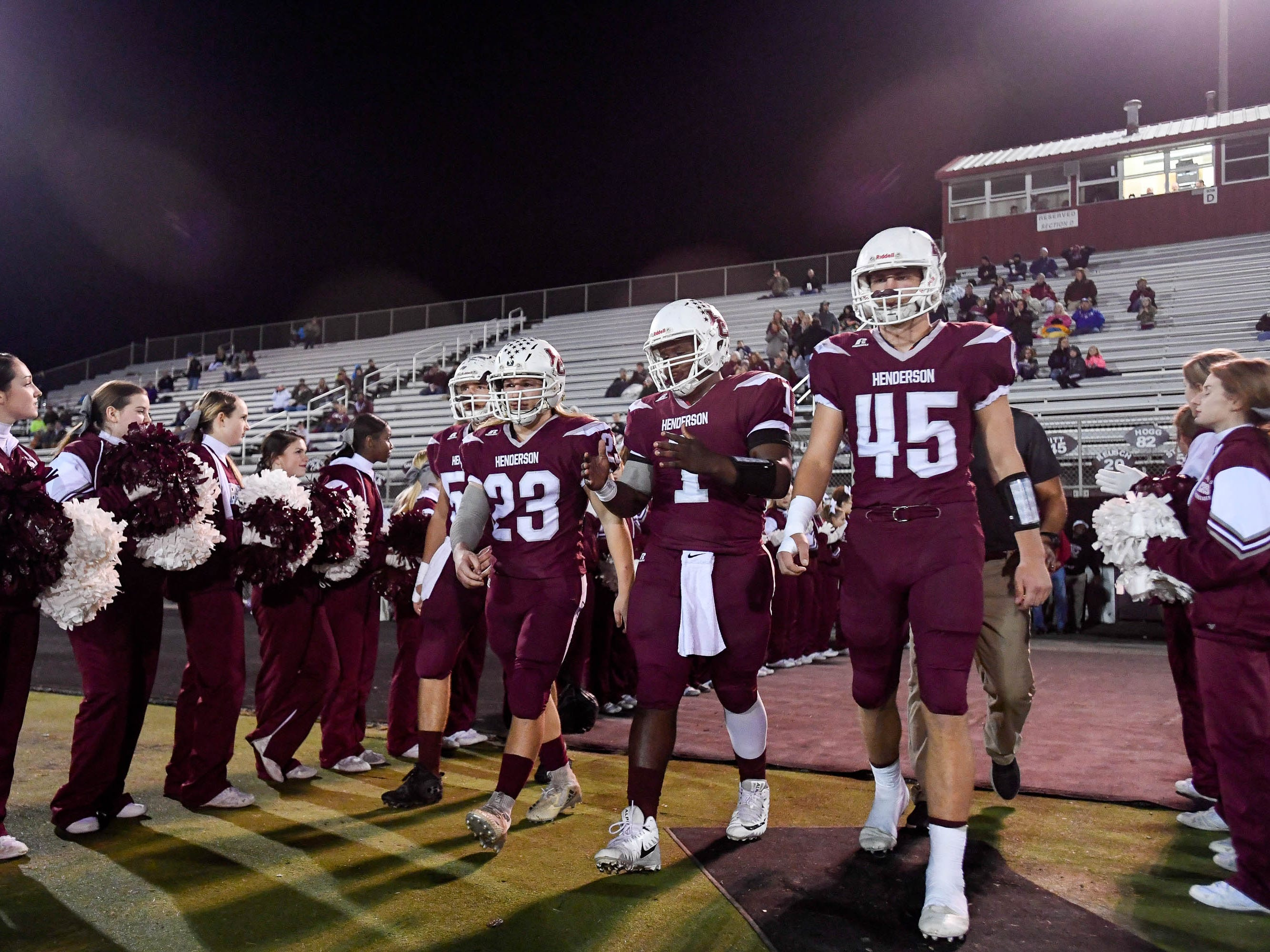 Team captains Henderson's Breck Bender (54), Meric Stinson (23) , Skip Patterson (1) and Ian Pitt (45) take the field for a the coin toss as the Henderson County Colonels play the Louisville Eastern Eagles in the first round of the 6-A playoffs at Colonel Field Friday, November 2, 2018.