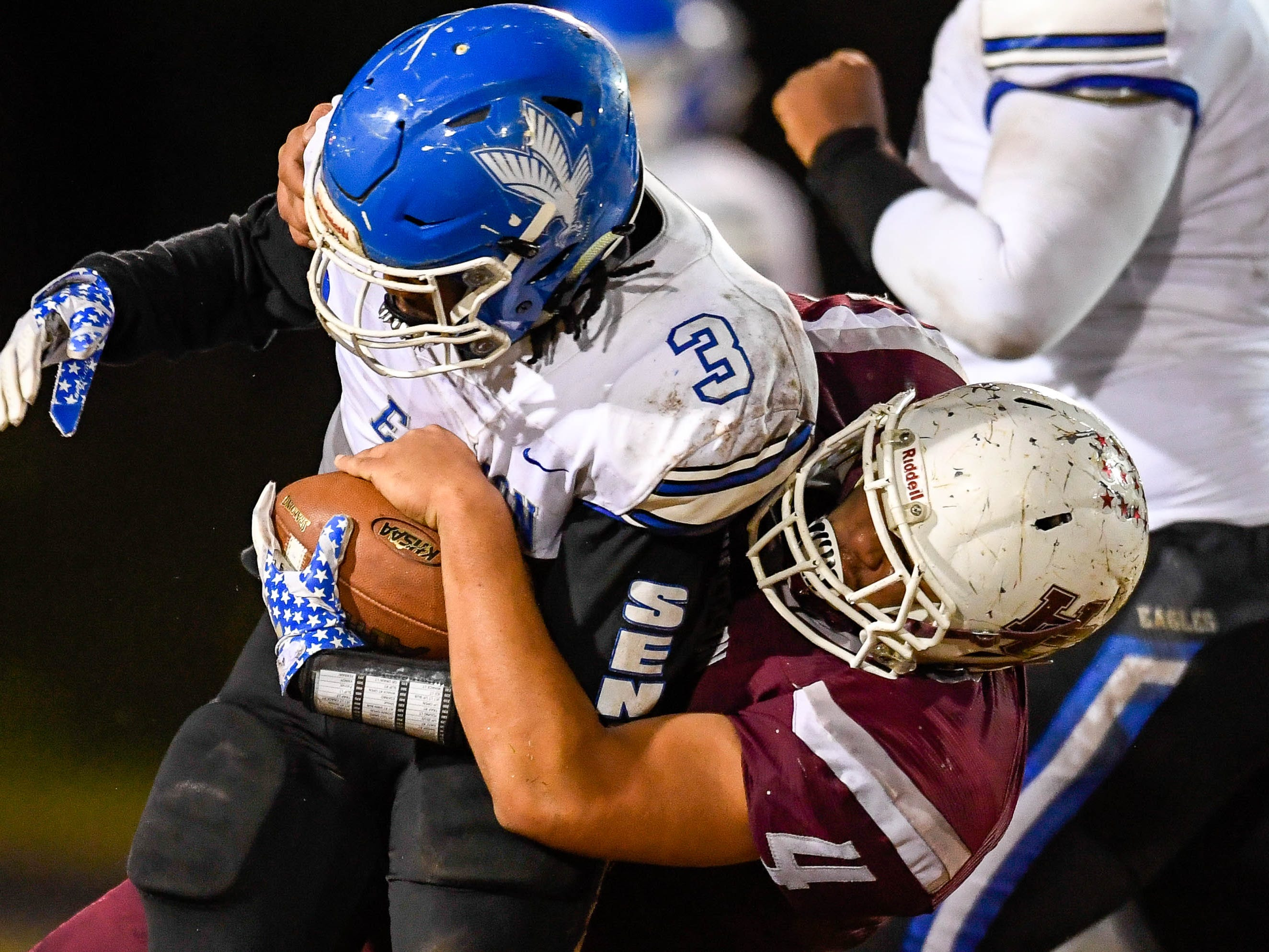 Henderson's Layton Fletcher (4)  tackles Eastern's Elijah Irvine (3) as the Henderson County Colonels play the Louisville Eastern Eagles in the first round of the 6-A playoffs at Colonel Field Friday, November 2, 2018.