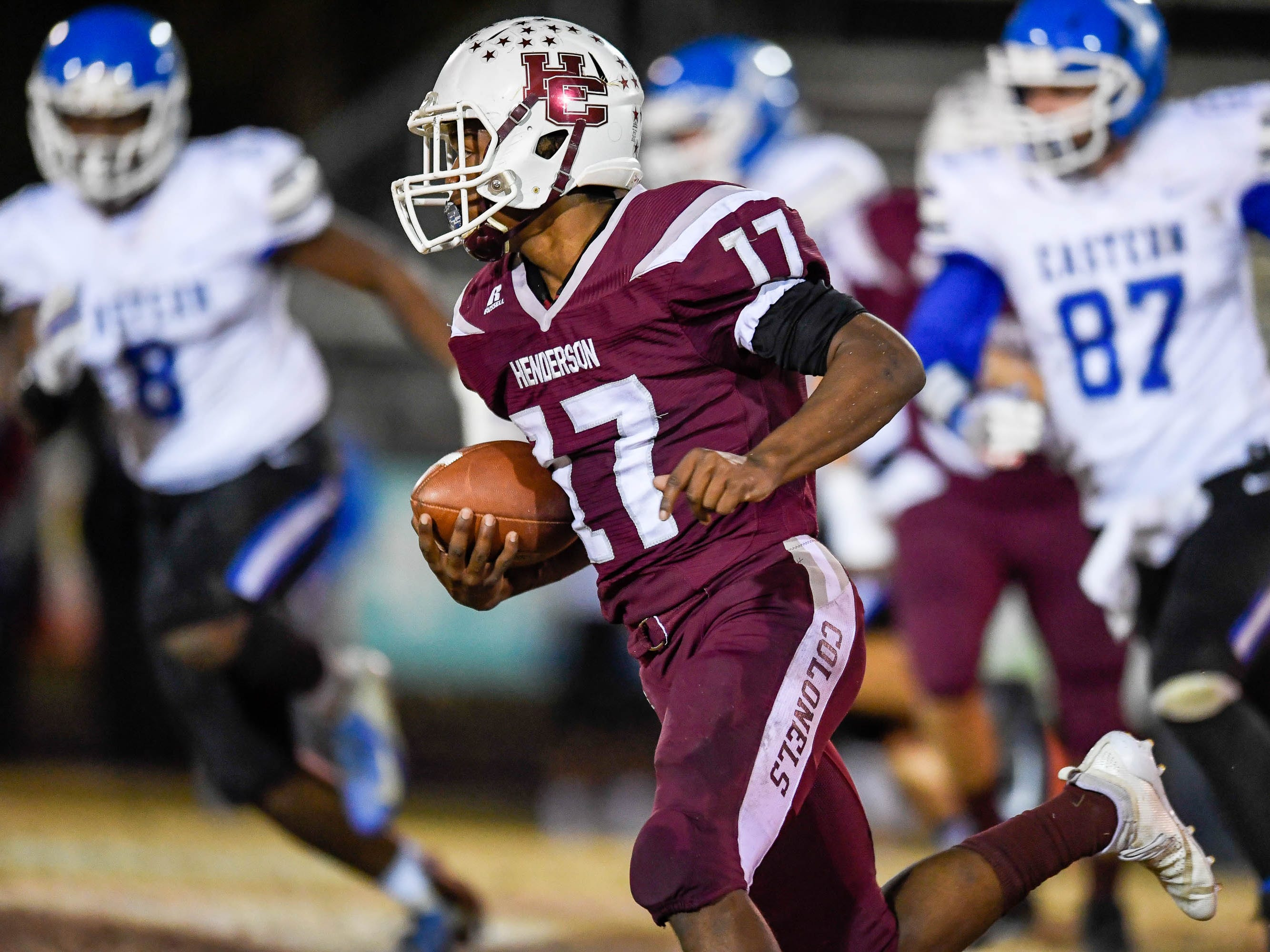 Henderson's Isaiah Easley (17) picks up big yards as the Henderson County Colonels play the Louisville Eastern Eagles in the first round of the 6-A playoffs at Colonel Field Friday, November 2, 2018.