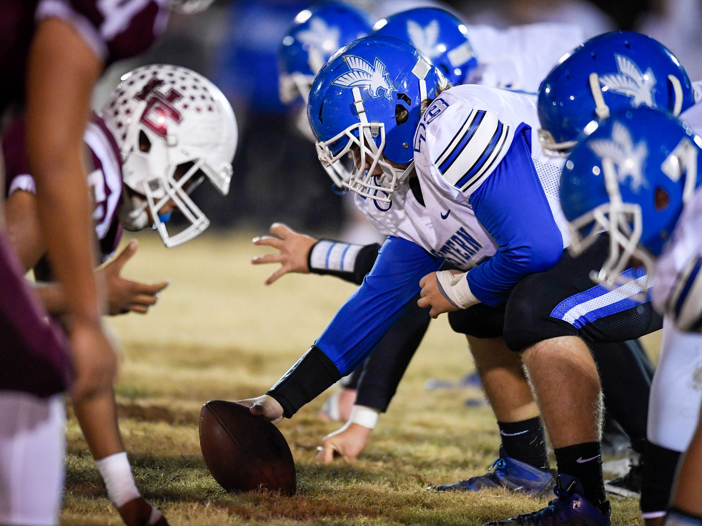 Eastern's James Fornash (73) prepares to snap the ball as the Henderson County Colonels play the Louisville Eastern Eagles in the first round of the 6-A playoffs at Colonel Field Friday, November 2, 2018.