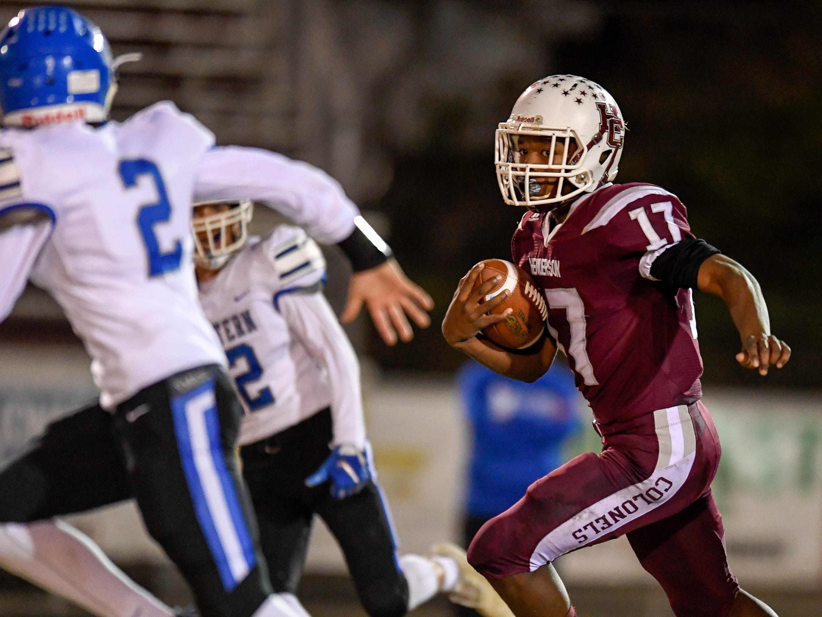 Henderson's Isaiah Easley (17) runs back a interception as the Henderson County Colonels play the Louisville Eastern Eagles in the first round of the 6-A playoffs at Colonel Field Friday, November 2, 2018.