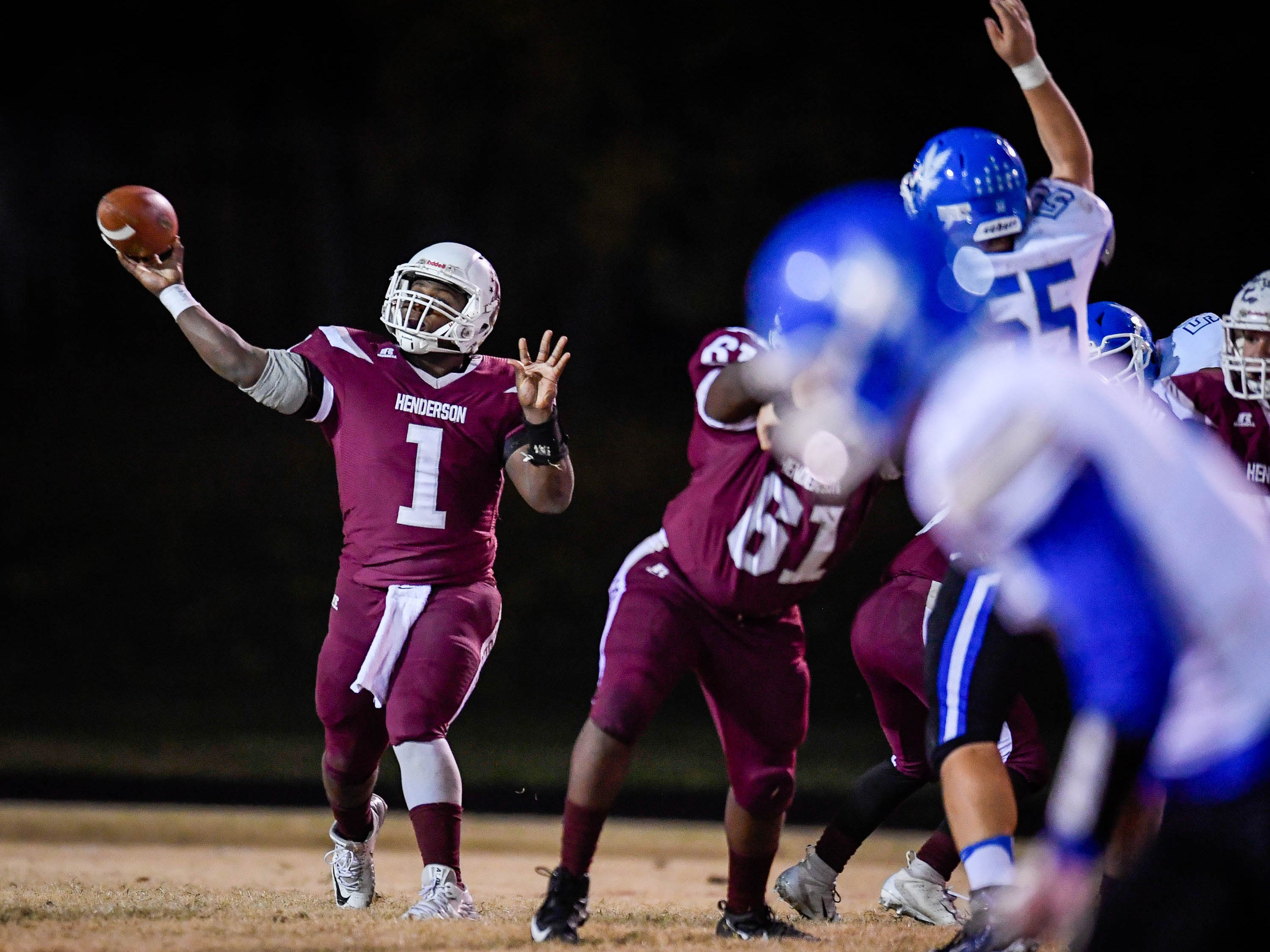 Henderson quarterback Skip Patterson (1) on a pass play as the Henderson County Colonels play the Louisville Eastern Eagles in the first round of the 6-A playoffs at Colonel Field Friday, November 2, 2018.