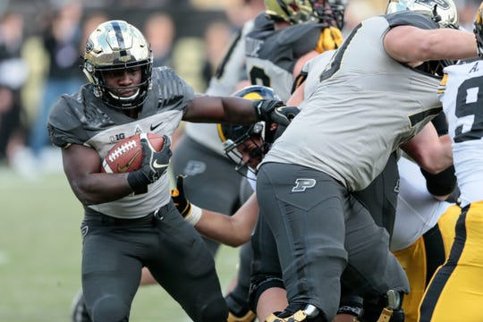 Purdue running back D.J. Knox (1) runs behind the line of scrimmage while playing Iowa in the first half of an NCAA college football game in West Lafayette, Ind., Saturday, Nov. 3, 2018. Purdue won 38-36.