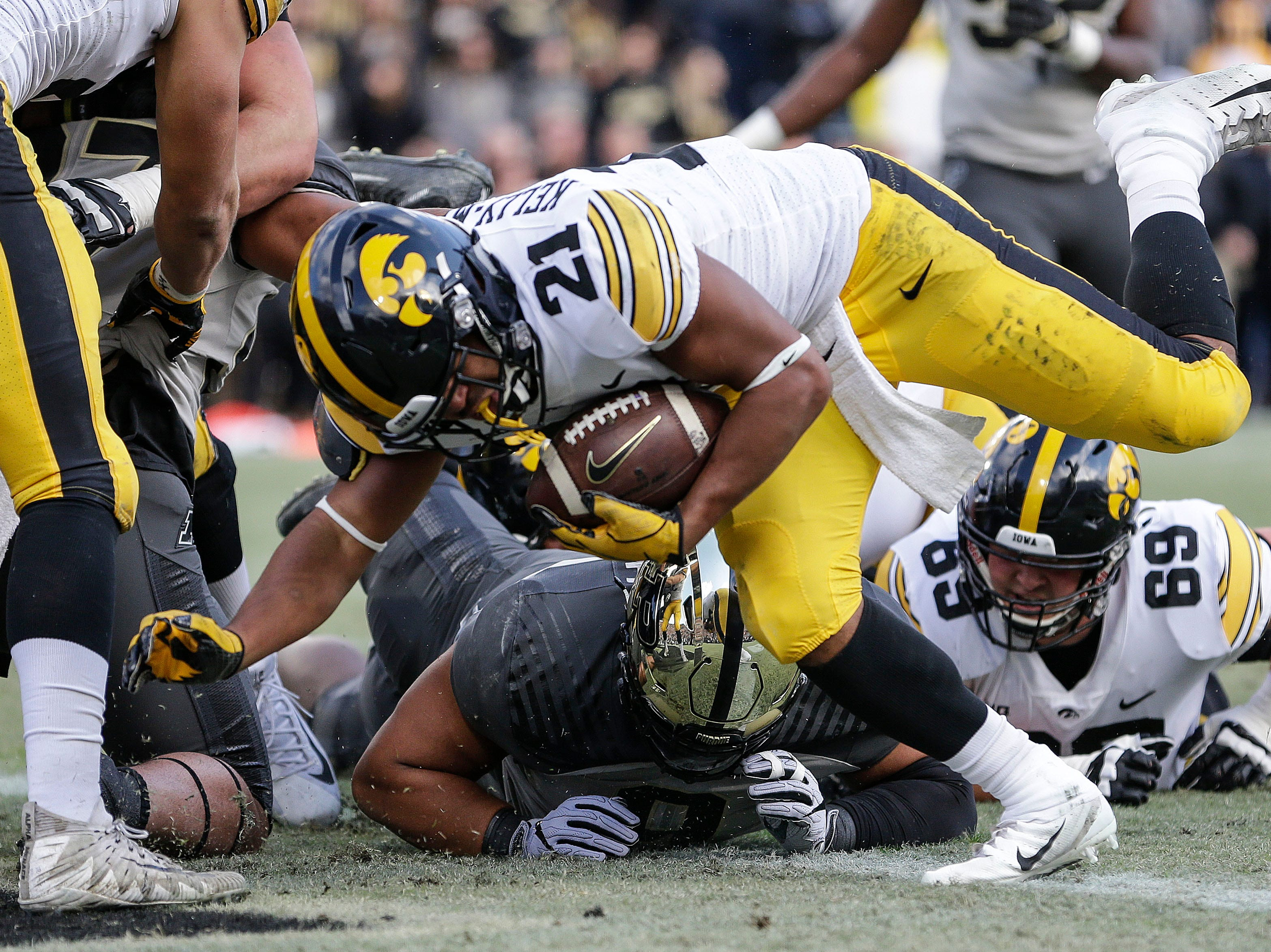 Iowa running back Ivory Kelly-Martin (21) scores a touchdown while playing against Purdue in the first half of an NCAA college football game in West Lafayette, Ind., Saturday, Nov. 3, 2018.