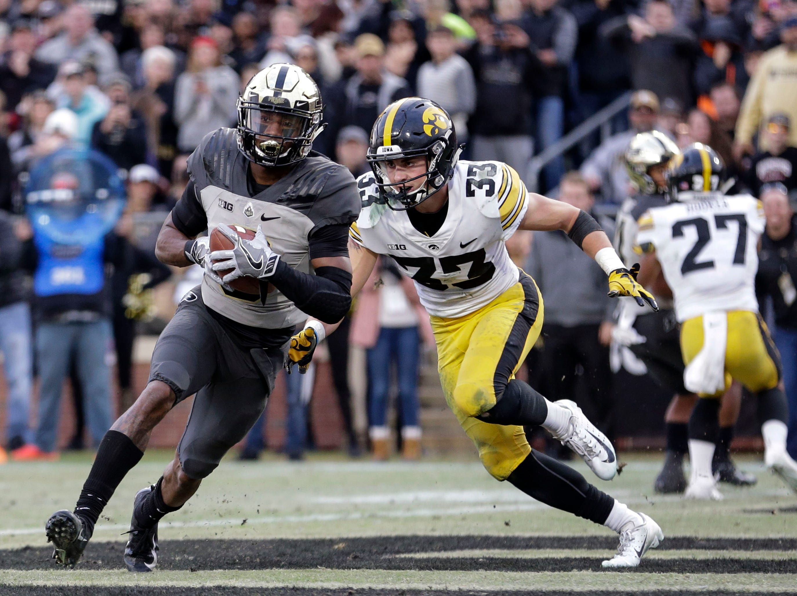 Purdue wide receiver Terry Wright, left, scores a touchdown in front of Iowa defensive back Riley Moss (33) in the second half of an NCAA college football game in West Lafayette, Ind., Saturday, Nov. 3, 2018.