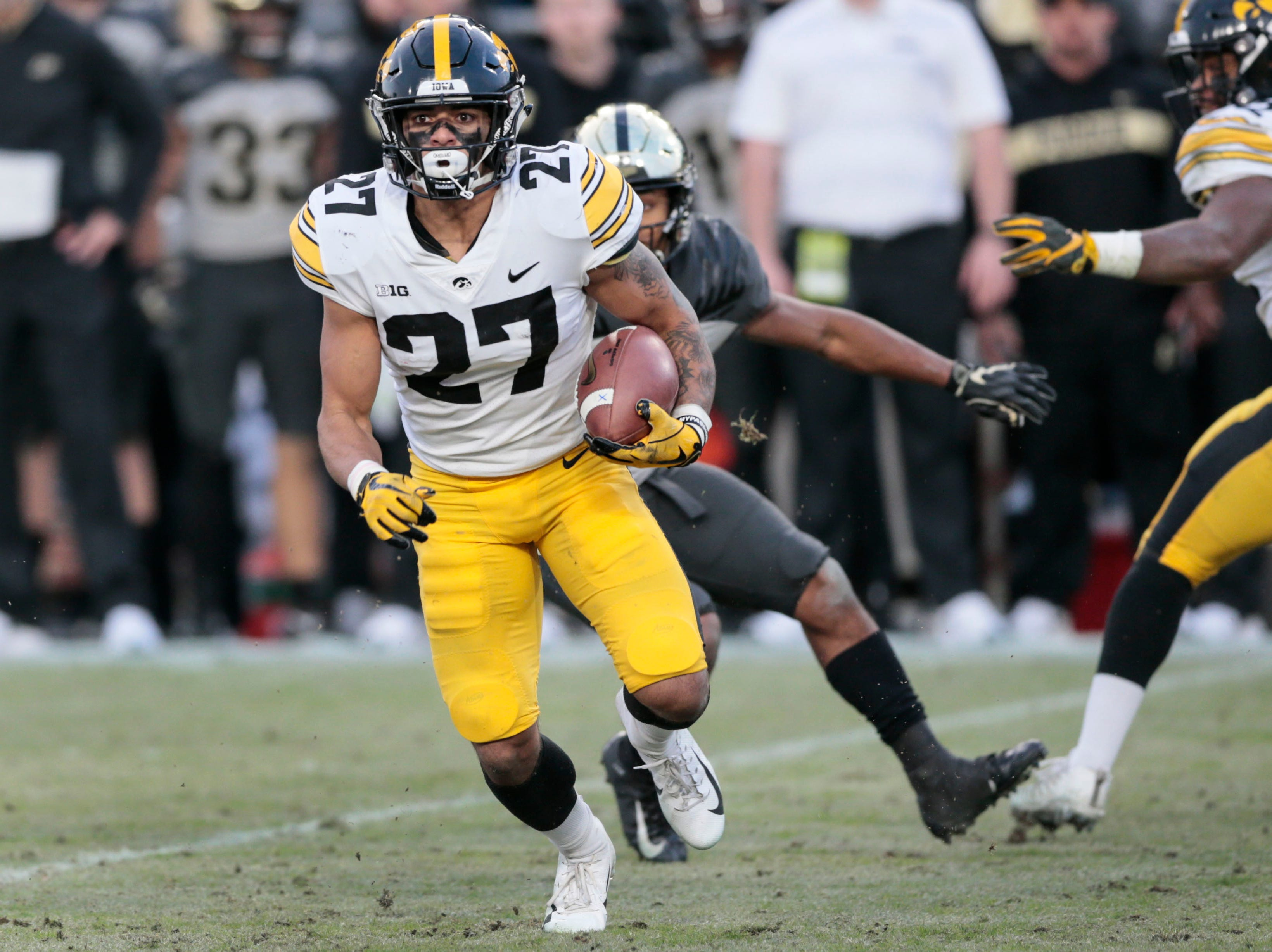 Iowa defensive back Amani Hooker (27) runs with the ball after intercepting it while playing Purdue in the second half of an NCAA college football game in West Lafayette, Ind., Saturday, Nov. 3, 2018.