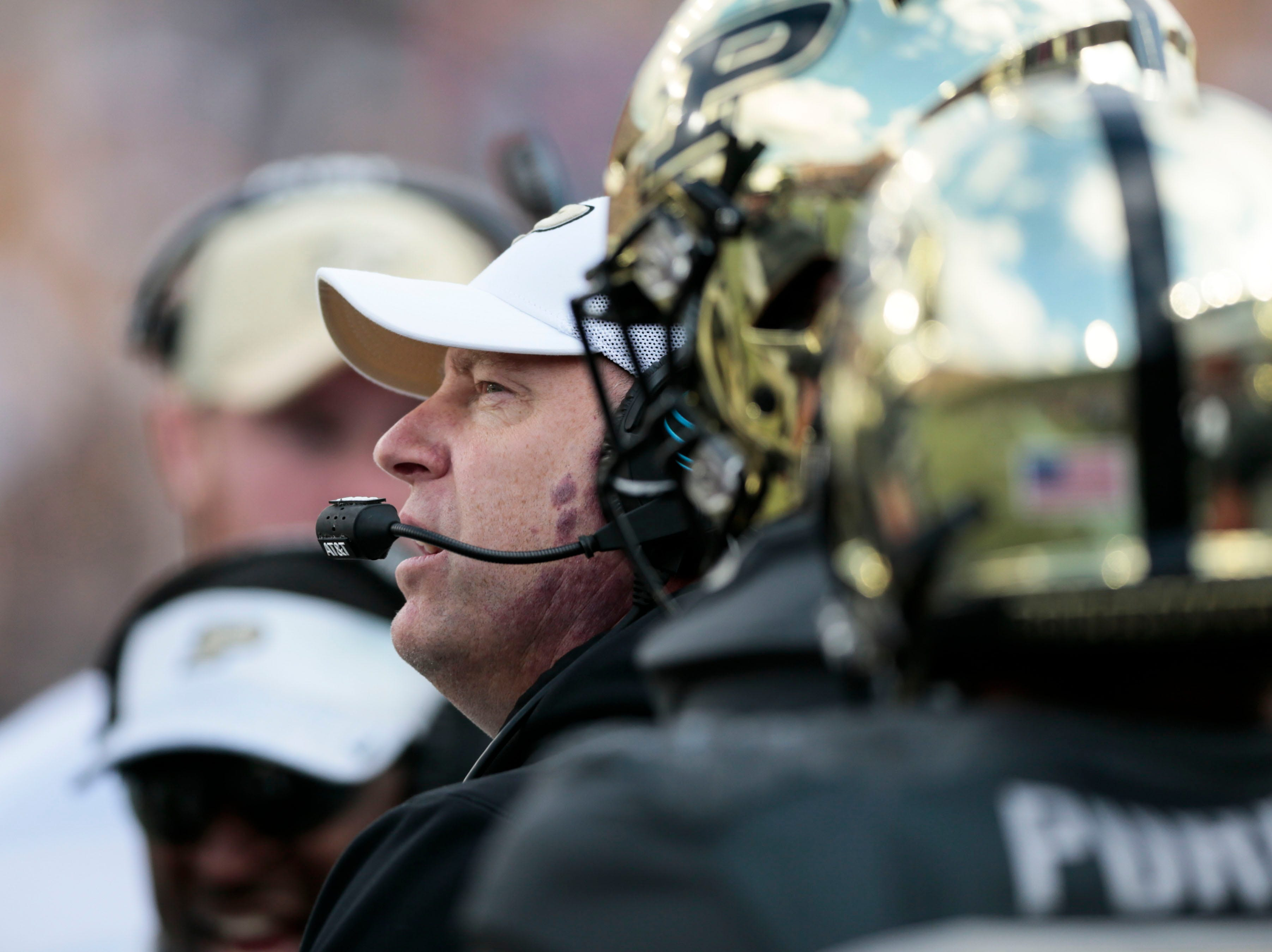 Purdue head coach Jeff Brohm talks to his team while playing against Iowa in the first half of an NCAA college football game in West Lafayette, Ind., Saturday, Nov. 3, 2018.