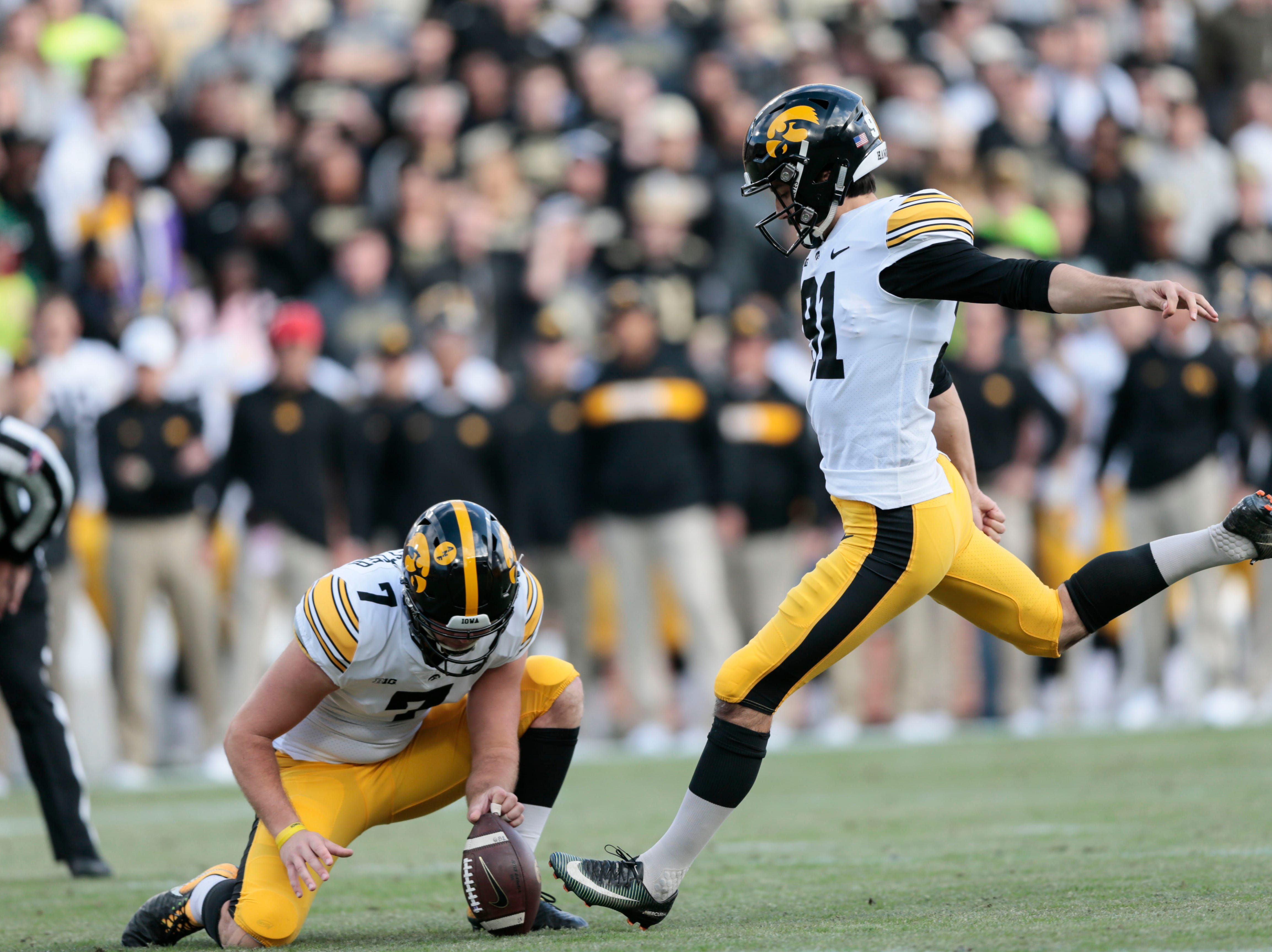 Iowa place kicker Miguel Recinos (91) boots a field goal from the hold of punter Colten Rastetter (7) while playing against Purdue in the first half of an NCAA college football game in West Lafayette, Ind., Saturday, Nov. 3, 2018.