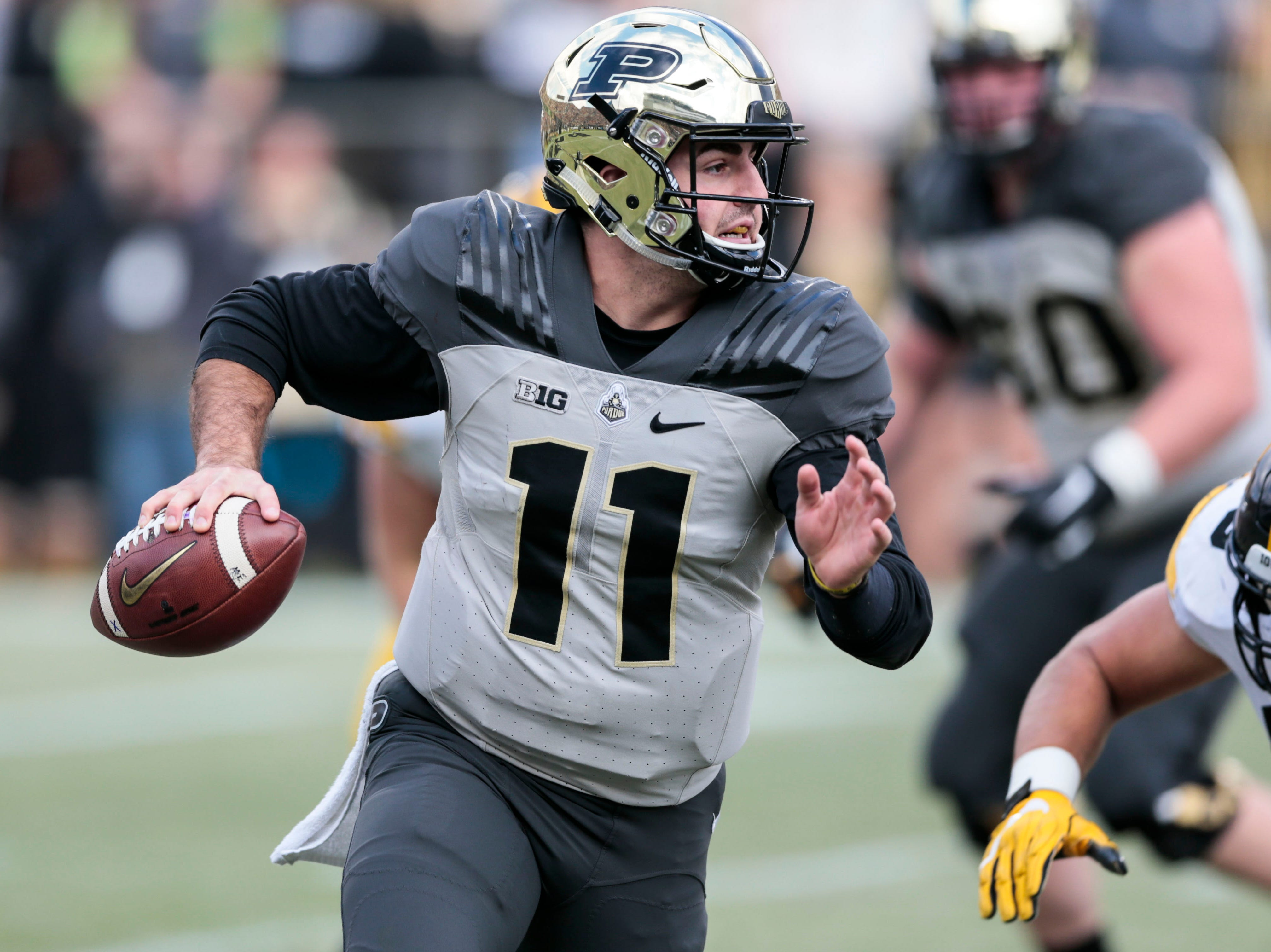 Purdue quarterback David Blough (11) runs with the ball while playing against Iowa in the first half of an NCAA college football game in West Lafayette, Ind., Saturday, Nov. 3, 2018.