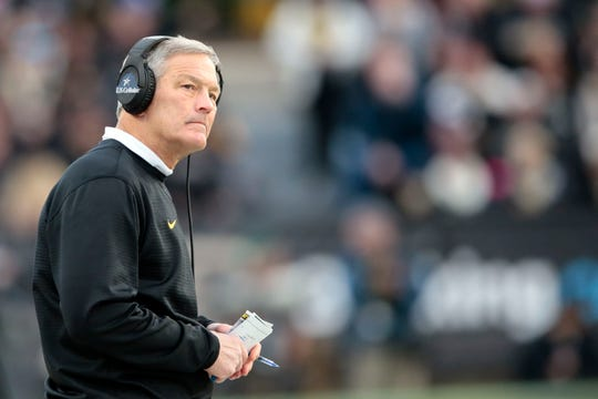 Iowa head coach Kirk Ferentz looks at the scoreboard while playing Purdue in the second half of an NCAA college football game in West Lafayette, Ind., Saturday, Nov. 3, 2018.