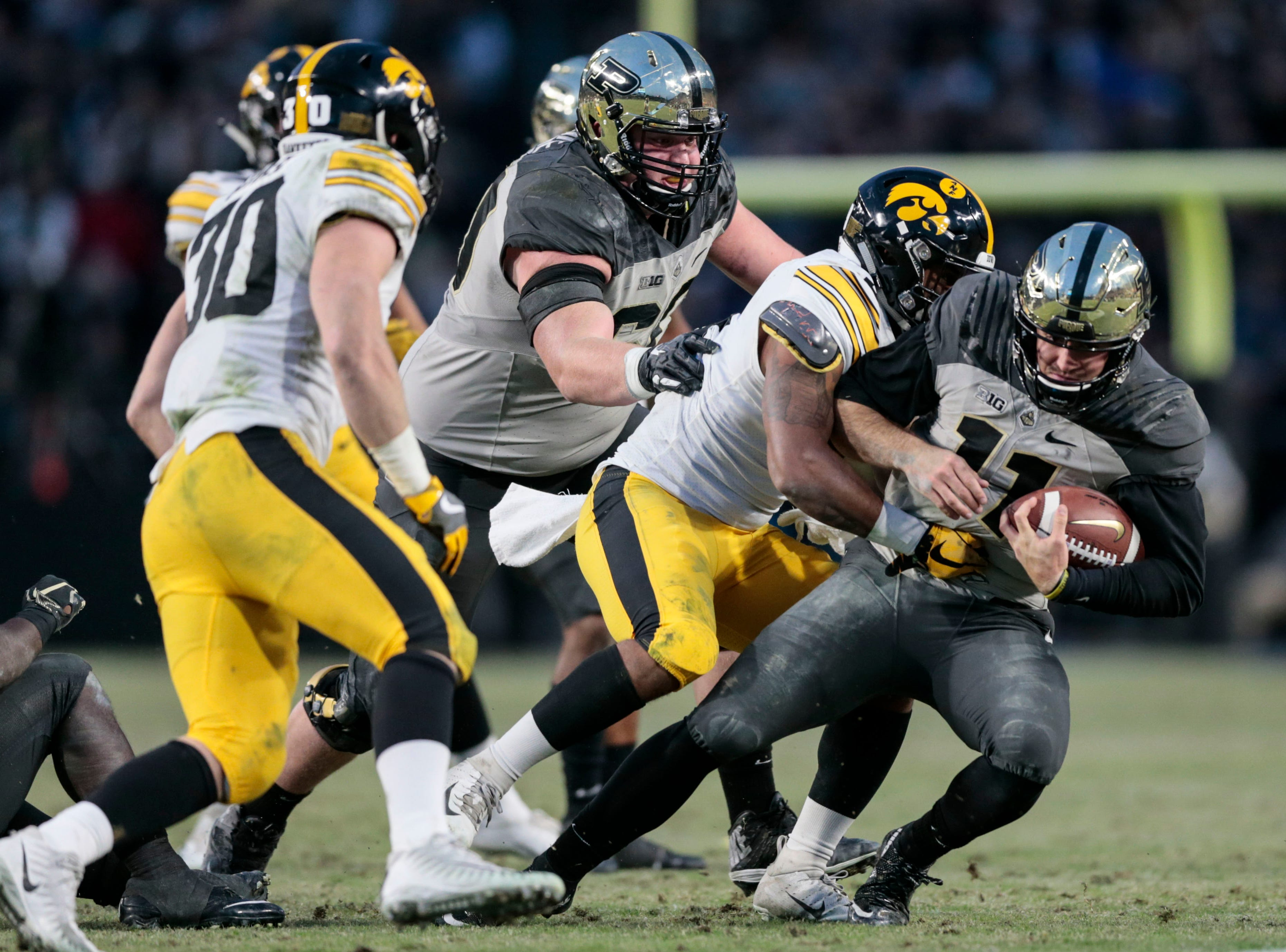 Purdue quarterback David Blough, right, gets tackled by Iowa defensive back Geno Stone (9) in the second half of an NCAA college football game in West Lafayette, Ind., Saturday, Nov. 3, 2018.