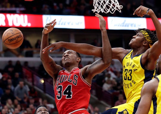 Indiana Pacers forward/center Myles Turner, right, blocks a shot by Chicago Bulls center Wendell Carter Jr., during the second half of an NBA basketball game Friday, Nov. 2, 2018, in Chicago. (AP Photo/Nam Y. Huh)