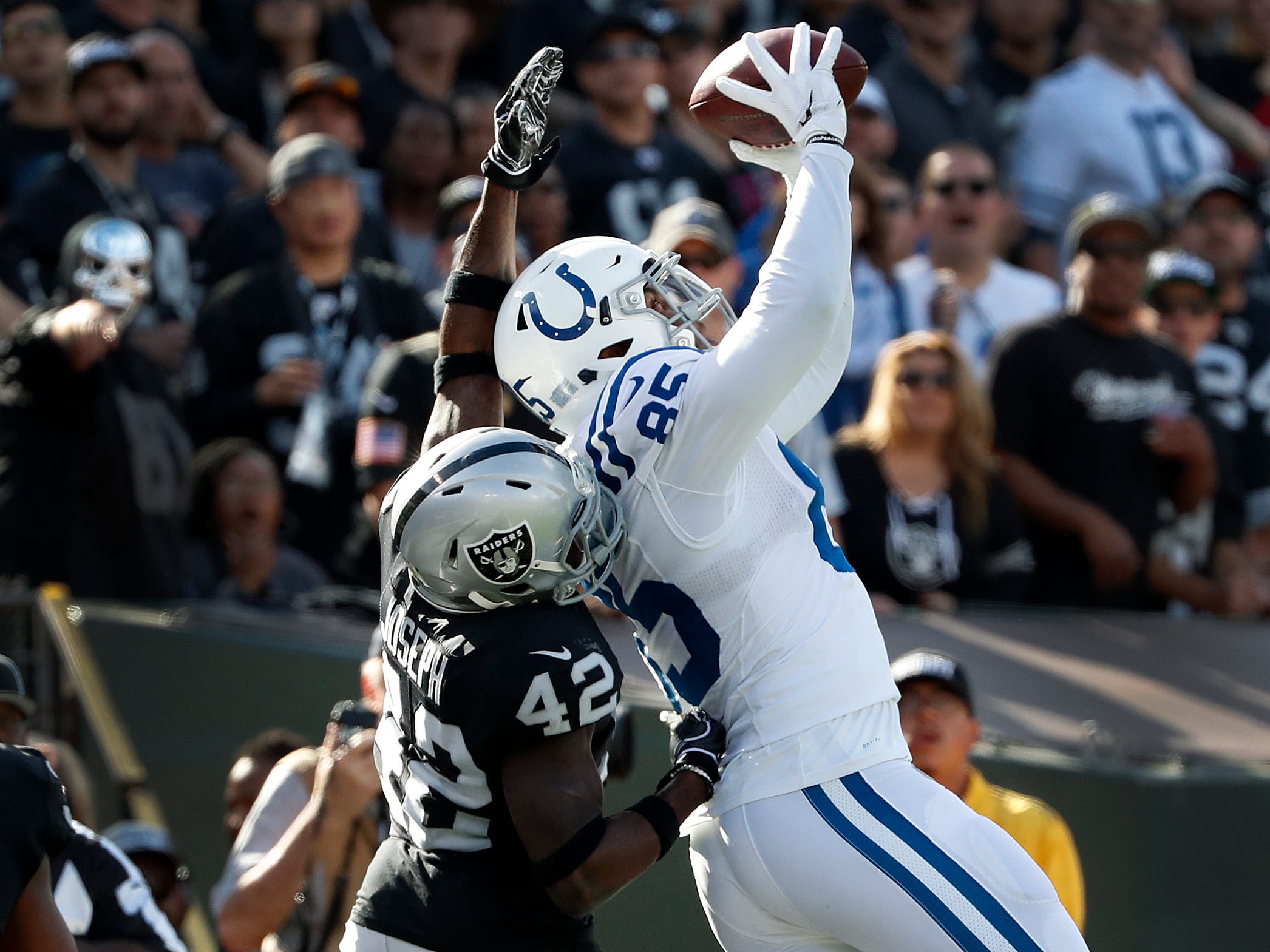 Indianapolis Colts tight end Eric Ebron (85) makes a touchdown catch over Oakland Raiders defensive back Karl Joseph (42) in the second half of their game at Oakland Alameda Coliseum in Oakland, CA., Sunday, Oct 28, 2018.