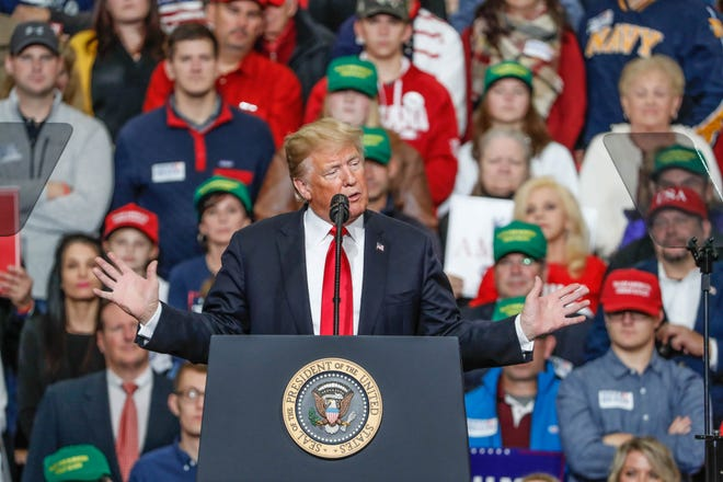United States President Donald Trump campaigns for Republican candidate Mike Braun during a rally at Southport Fieldhouse on Friday, Nov. 2, 2018.