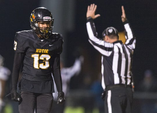 Avon High School sophomore Wallace Stovall Jr (13) celebrates a touchdown reception in the end zone during the first half of action. Avon High School hosted Brownsburg High School in an IHSAA varsity football Class 6A Sectional Championship game, Friday, Nov. 2, 2018.