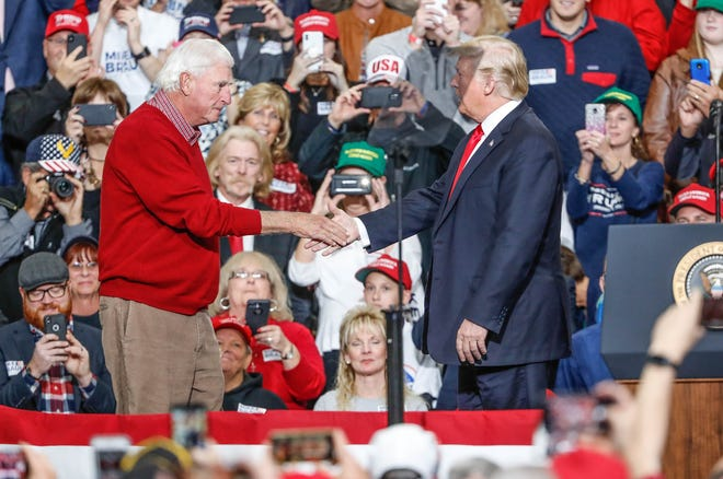 United States President Donald Trump greets former IU head coach Bobby Knight during a rally for Republican senatorial candidate Mike Braun at Southport Fieldhouse on Friday, Nov. 2, 2018.