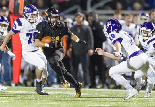 Avon High School senior Jalen Peterson (11) rushes the ball out of the backfield during the first half of action. Avon High School hosted Brownsburg High School in an IHSAA varsity football Class 6A Sectional Championship game, Friday, Nov. 2, 2018.