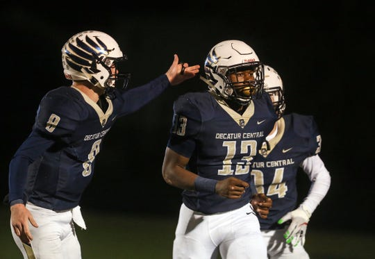 Decatur Central's Kenneth Tracy (13) scores a touchdown against Cathedral in the first half of the sectional final game at Decatur Central High School in Indianapolis, Ind., Saturday, Nov. 2, 2018. The Hawks defeated the Irish 21-14 for the sectional championship title.