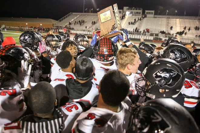 North Central celebrates with their trophy following their 42-7 victory at the end of Fishers vs North Central  High School varsity football in the Class 6A Sectional Championship held at Fishers High School, Friday, November 2, 2018.