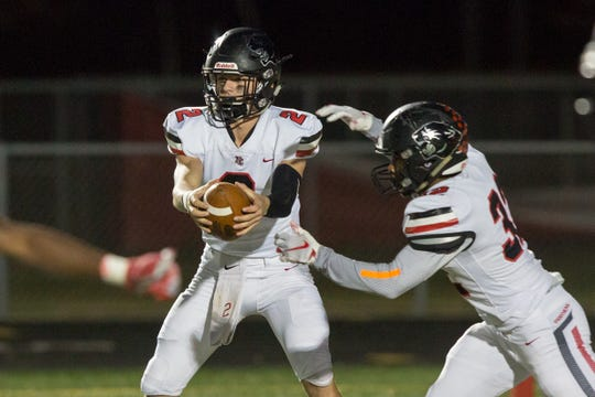 North Central Liam Thompson (2)  hands off to North Central Alexander Tarver (32) during the first half of Fishers vs North Central  High School varsity football in the Class 6A Sectional Championship held at Fishers High School, Friday, November 2, 2018.