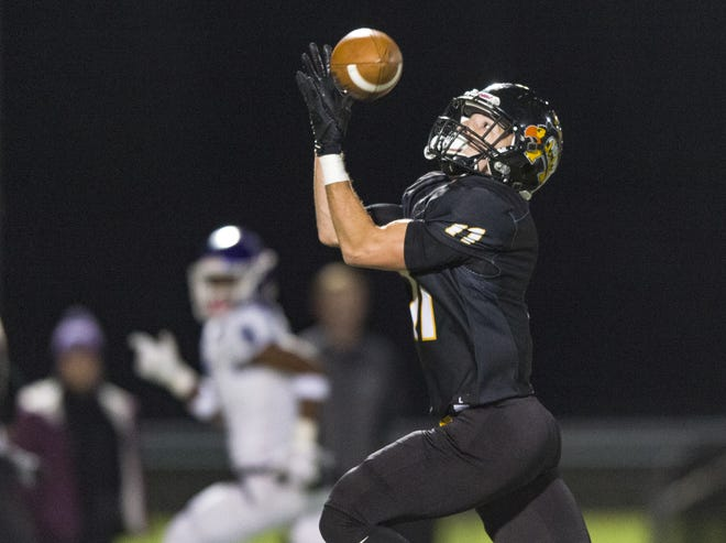 Avon High School senior Jalen Peterson (11) makes a pass reception, ultimately running the ball into the end zone to score, during the first half of action. Avon High School hosted Brownsburg High School in an IHSAA varsity football Class 6A Sectional Championship game, Friday, Nov. 2, 2018.