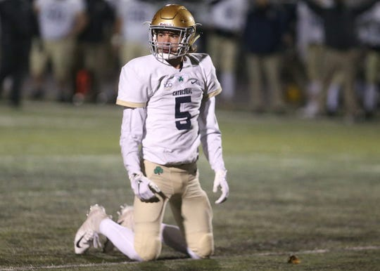 Cathedral's Bo Sanders (5) takes a moment after an incomplete pass against Decatur Central in the first half of the sectional final game at Decatur Central High School in Indianapolis, Ind., Saturday, Nov. 2, 2018. The Hawks defeated the Irish 21-14 for the sectional championship title.