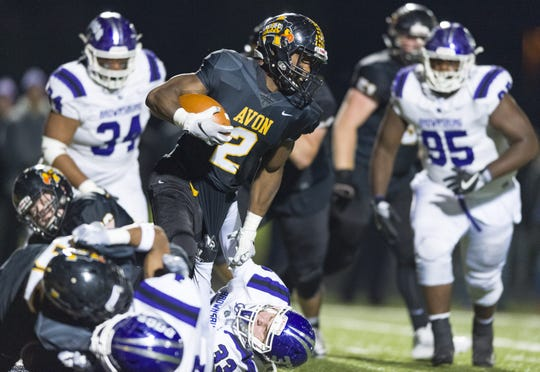 Avon High School senior Sampson James (2) breaks into the Brownsburg secondary during the first half of action. Avon High School hosted Brownsburg High School in an IHSAA varsity football Class 6A Sectional Championship game, Friday, Nov. 2, 2018.