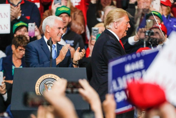 Vice President Mike Pence and President Donald Trump campaign for Republican candidate Mike Braun during a rally at Southport Fieldhouse on Friday, Nov. 2, 2018.