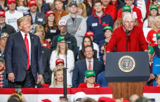 United States President Donald Trump, left, listens as former IU head coach Bobby Knight speaks during a rally for Republican senatorial candidate Mike Braun at Southport Fieldhouse on Friday, Nov. 2, 2018.