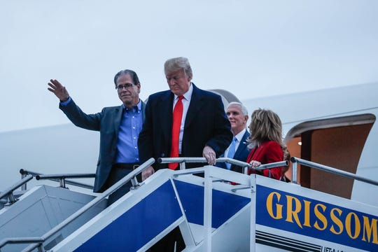 Senatorial candidate Mike Braun, left, United States President Donald Trump, center left, Vice President Mike Pence, center right, and Maureen Braun, right, disembark Airforce One after landing at the Indianapolis International Airport on Friday, Nov. 2, 2018.