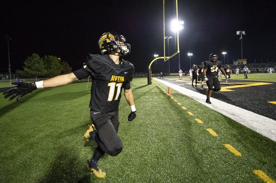 Avon High School senior Jalen Peterson (11) reacts as he crosses into the end zone to score during the first half of action. Avon High School hosted Brownsburg High School in an IHSAA varsity football Class 6A Sectional Championship game, Friday, Nov. 2, 2018.