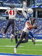 Indianapolis Colts tight end Eric Ebron (85) went up and over Houston Texans linebacker Zach Cunningham (41) for  a touchdown catch at Lucas Oil Stadium on Sept. 30.