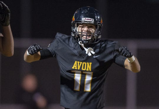Avon High School senior Jalen Peterson (11) reacts in the end zone after pulling in a reception on the first play from scrimmage to score during the first half of action. Avon High School hosted Brownsburg High School in an IHSAA varsity football Class 6A Sectional Championship game, Friday, Nov. 2, 2018.