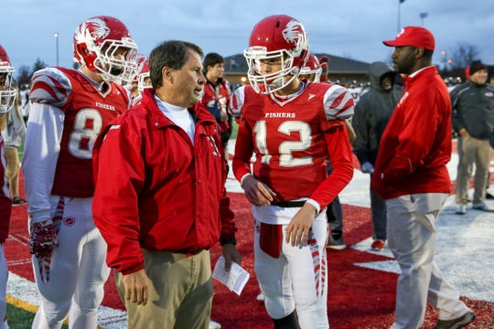 Fisher Coach Rick Wimmer discusses the game plan with Fisher's Marcus Roux (12) prior to the start of of Fishers vs North Central  High School varsity football in the Class 6A Sectional Championship held at Fishers High School, Friday, November 2, 2018.